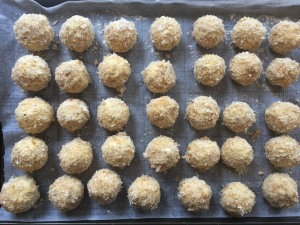 Mashed potato balls coated and ready to deep fry